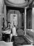 Maid Cleaning Ambassador Laurence A. Steinhardt's Residence Bathroom Impressão fotográfica por Nat Farbman