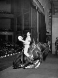 Gene Autry Astride His Famous Horse Champion on Bent Front Knees, Touching Head to Floor, on Stage Premium Photographic Print by Thomas D. Mcavoy