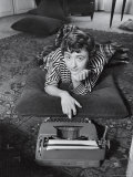 French Authoress Francoise Sagan, Laying on the Floor Typing Premium Photographic Print by Thomas D. Mcavoy