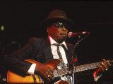 Blues Singer and Guitarist John Lee Hooker Performing Lámina fotográfica prémium