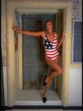 Model Standing in Doorway Modeling Ralph Lauren's Cotton and Lycra One Piece Flag Bathing Suit Fotoprint van Ted Thai