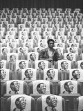Comedian Bill Cosby Sitting in Empty Auditorium Filled with Copies of His Likeness on Each Seat Premium Photographic Print by Michael Rougier