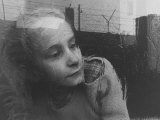 Girl Gazing Pensively Through Pane of Her Apartment Window, Grimly Reflects Image of Berlin Wall Photographic Print by Paul Schutzer