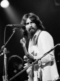 George Harrison Performing at a Rock Concert Benefiting Bangladesh, aka Kampuchea Impressão fotográfica premium por Bill Ray