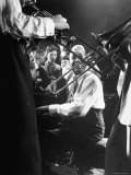Composer Pianist Duke Ellington Playing Piano Amidst Two Trombonists during After Hours Jam Session Premium Photographic Print by Gjon Mili