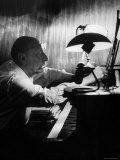 Composer Igor Stravinsky Working at a Piano in an Empty Dance Hall in Venice Impressão fotográfica premium por Gjon Mili