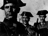 "Members of Dictator Franco's Feared Guardia Civil in Rural Spain, from Essay ""Spanish Village."" Reproduction photographique par W. Eugene Smith"