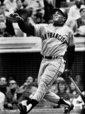 Baseball Player Willie Mays Watching Ball Clear Fence for Home Run in Game with Dodgers Premium fototryk af Ralph Morse