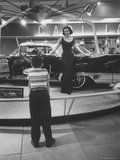 Model Posing Beside Cadillac Eldorado Captures Attention of Young Boy at National Automobile Show Photographic Print by Walter Sanders