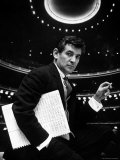 36 Year Old Composer Leonard Bernstein, Holding Musical Score with Lighted Auditorium Behind Him Premium Photographic Print by Gordon Parks