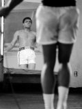 Boxer Muhammad Ali Jumping Rope While Watching Himself in Mirror During Training for His Fight Premium Photographic Print by John Shearer
