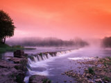 Sunrise in the morning mist over the waterfall on the Venta River near Kuldiga, Latvia Photographic Print by Janis Miglavs