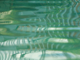 Smooth Green Water Rippling in a Pool Fotografie-Druck