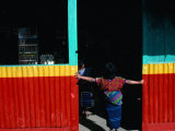 Girl Standing in Market Doorway, Santa Maria De Jesus, Guatemala Fotografie-Druck von Jeffrey Becom