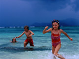 Children Running Out of Ocean in Stormy Weather, Seychelles Photographic Print by Philip & Karen Smith