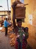 Mother Carrying Baby and Basket, Mombasa, Kenya Photographic Print by Wayne Walton