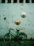 Conical Hats Hang on Wall Above Bicycle in Historic Old Quarter, Hanoi, Vietnam Stampa fotografica di Richard I'Anson