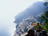 Couple Reading Guidebook on Lookout Above Town, Positano, Italy Photographic Print by Philip & Karen Smith