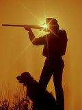 Silhouetted Hunter with Dog Lámina fotográfica