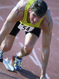 Close-up of a Young Man in the Starting Position on a Running Track Photographic Print