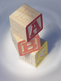 Three Wooden Letter Blocks of the Abcs Photographic Print