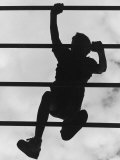 Boy Climbing on Jungle Gym Photographic Print by Russell Burden