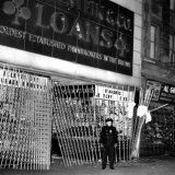 A Policeman Stands in Front of a Pawn Shop Photographic Print