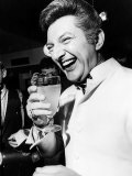 Liberace Pianist Drinks a Soft Drink at a Press Conference, March 1968 Photographic Print