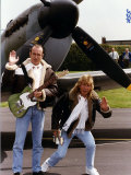 Status Quo Members Francis Rossi and Rick Parfitt Posing by a Spitfire Aircraft in Northolt Fotografisk tryk