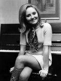 Lulu Wearing Mini Dress and Sitting on a Piano Stool Photographic Print