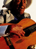 Portrait of Old Man Playing Guitar, Paracas, Peru Photographic Print by Jeffrey Becom
