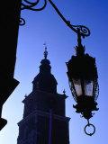 Lamp Post with Town Hall Tower (Wieza Ratuszowa) in Background, Krakow, Poland Photographic Print by Krzysztof Dydynski