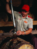 Taking Sample from Whisky Barrel at Makers Mark Distillery, Bardstown, United States of America Fotografie-Druck von Richard I'Anson
