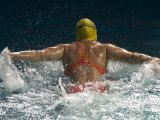 Young Woman Swimming the Butterfly Stroke in a Swimming Pool, Bainbridge Island, Washington, USA Photographic Print