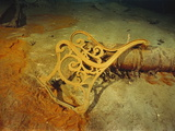 """Metal Deck Bench Frame of the R.M.S. """"Titanic"""" Seen Amid Wreckage on Ocean Floor Photographic Print by Emory Kristof"""