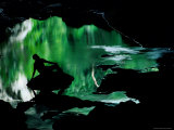A Man is Silhouetted against an Emerald Green Pool of Water Fotografisk tryk af Raymond Gehman