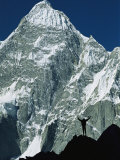 A Climber Silhouetted against Mountains in the Karakoram Range Photographic Print by Jimmy Chin
