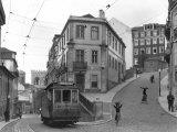 Lisbon Street Scene with Tramcar Fotografisk tryk af W. Robert Moore