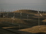 Rows of Windmills on Open Hills Produce Alternative Sources of Energy Photographic Print by Sam Kittner
