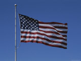 The American Flag Flies Proudly in a Stiff Breeze Fotografisk trykk av Stephen St. John