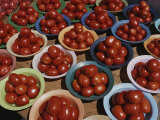 Roma Tomatoes Fill Colorful Bowls at a Vendors Stall Photographic Print by Tino Soriano