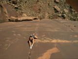 A Young Woman Climbing in Canyonlands, Utah Photographic Print by Jimmy Chin