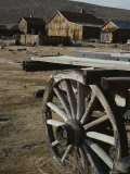 A View of Buildings and an Old Wagon at Bodie Ghost Town Photographic Print by Gordon Wiltsie
