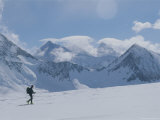 A Man Skis Across Patton Glacier Photographic Print by Gordon Wiltsie