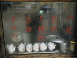 Teapots on the Sill of a Restaurant Window Covered with Steam Fotografie-Druck von Ed George