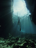 A Woman Swimming in Sunlight Beaming Through Clear Tropical Waters, Isle Cocos Fotografisk trykk