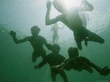 Underwater View of Moken Divers Swimming Underwater Photographic Print by Nicolas Reynard