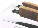 Toast Popping out of Sleek Stainless Steel Toaster Photographic Print