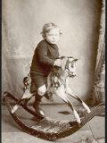 Little Boy on a Rocking Horse Lámina fotográfica