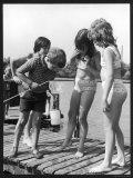 Group of Children Including Girls in Bikinis Inspect Their Net for Fish Impressão fotográfica